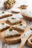 Toasts with cheese pate and capers Stock Photos