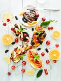 Toasts with chocolate and fruits. Toasts with chocolate and cheese spreat with berries and fruits. Shallow dof Stock Photography