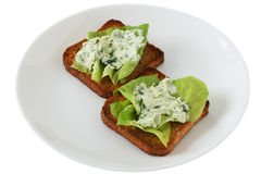Toasts with cream cheese and spinach Stock Image