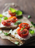 Toasts (Crostini) with ricotta and cherry tomatoes Royalty Free Stock Photos