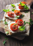 Toasts (Crostini) with ricotta and cherry tomatoes Royalty Free Stock Image
