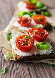 Toasts (Crostini) with ricotta and cherry tomatoes Stock Photography