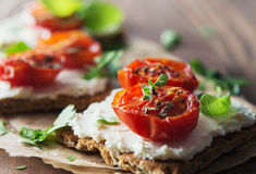 Toasts (Crostini) with ricotta and cherry tomatoes Stock Images