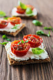 Toasts (Crostini) with ricotta and cherry tomatoes Stock Photos