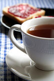 Toasts and cup of tea. Picture of a toasts and jam and cup of tea standing on a table Royalty Free Stock Photos