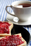 Toasts and cup of tea. Picture of a toasts and jam and cup of tea standing on a table Stock Image