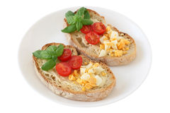 Toasts with cut egg and tomato Royalty Free Stock Photos
