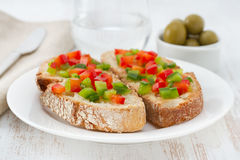 Toasts with cut pepper Royalty Free Stock Photography