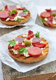 Toasts with dried tomatoes, pepperoni and ricotta Royalty Free Stock Photography