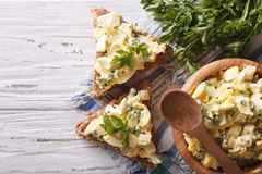 Toasts and egg salad with herbs horizontal top view Royalty Free Stock Photography