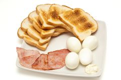 Toasts, eggs, bacon Stock Images