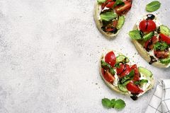 Toasts with feta,tomato,cucumber and mint.Top view with space fo royalty free stock images