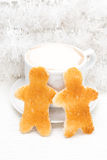 Toasts in the form of little men, coffee and Christmas tinsel Royalty Free Stock Photography