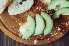 Toasts with fresh avocado. Bruschetta with ripe green avocado. Royalty Free Stock Photos