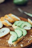 Toasts with fresh avocado. Bruschetta with ripe green avocado. Royalty Free Stock Photo