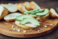Toasts with fresh avocado. Bruschetta with ripe green avocado. Stock Images