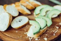 Toasts with fresh avocado. Bruschetta with ripe green avocado. Royalty Free Stock Photography