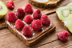 Toasts with fruits and berries for breakfast Royalty Free Stock Photo