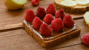 Toasts with fruits and berries for breakfast stock video