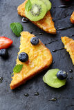 Toasts with fruits and honey Royalty Free Stock Photography
