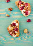 Toasts with grape, sweet and healthy breakfast. On blue wooden table Royalty Free Stock Photos