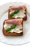 Toasts with ham and cheese Stock Photos