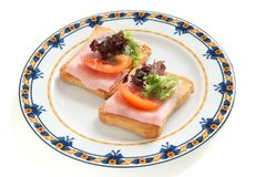 Toasts with ham and lettuce Stock Photography