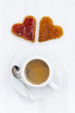 Toasts in heart shape with fruit jam and cup of coffee Royalty Free Stock Images