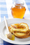Toasts with honey royalty free stock image