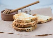 Toasts and honey Royalty Free Stock Photography