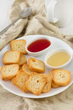 Toasts with jam in bowls Stock Photography