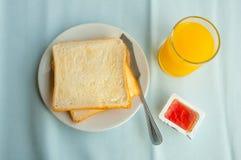 Toasts, jam and orange juice Stock Image