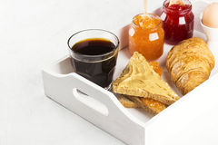 Toasts with jam and peanut paste, croissant, coffee Stock Image