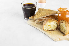 Toasts with jam and peanut paste, croissant, coffee Stock Photography