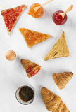Toasts with jam and peanut paste, croissant, coffee Royalty Free Stock Images
