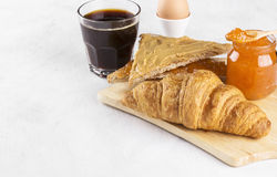 Toasts with jam and peanut paste, croissant, coffee Stock Photos