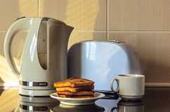 Toasts, kettle and toaster. Royalty Free Stock Photography
