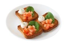 Toasts with mozzarella and tomato Royalty Free Stock Photo