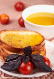 Toasts, olive oil, basil grass and tomatos Royalty Free Stock Image