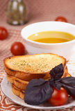 Toasts, olive oil, basil grass and tomatos Royalty Free Stock Photography