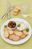 Toasts with olives and sauce Royalty Free Stock Photo