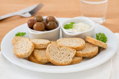 Toasts with olives and sauce Stock Photo