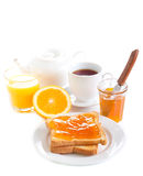 Toasts with orange marmalade Royalty Free Stock Photo