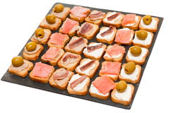 Toasts with pate, cheese, salmon. A tray with toasts with pate, cheese, salmon Royalty Free Stock Photography