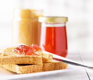 Toasts with peanut butter and strawberry jam Stock Photography