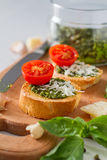 Toasts with pesto sause and tomatoes Stock Photo