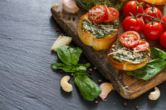 Toasts with pesto sause and tomatoes Royalty Free Stock Photography