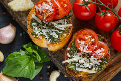 Toasts with pesto sause and tomatoes Royalty Free Stock Photo