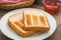 Toasts on plate and strawberry jam Royalty Free Stock Photography