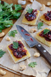 Toasts with plum chutney, garlic, cashew nuts and coriander leav Royalty Free Stock Images